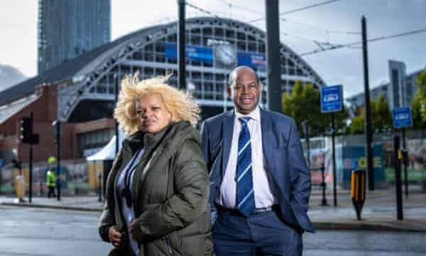 Julia Davidson, who works with Windrush families in Peterborough, and Anthony Brown, co-founder of the Windrush Defenders group, outside the Conservative conference at the Manchester Central Convention Complex