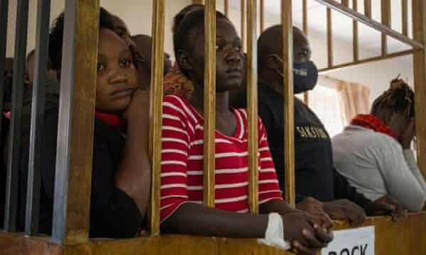 People in the dock at a court hearing in Kampala on 8 February.
