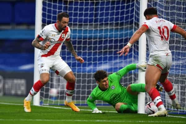 Che Adams scores past Kepa Arrizabalaga.