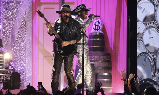 Billy Ray Cyrus and Lil Nas X perform Old Town Road at the 2020 Grammys.